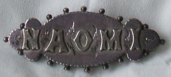 Naomi's name pin